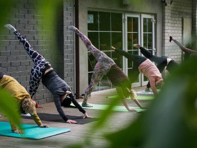 group doing yoga outside