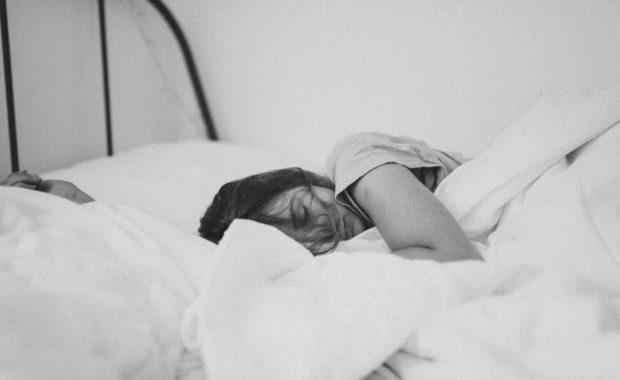 sleep breathing disorders - woman in bed